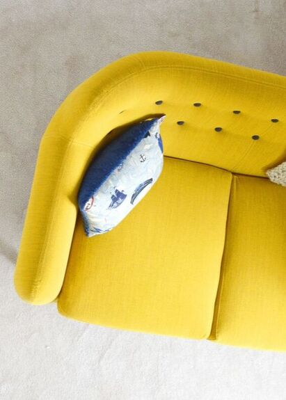 Yellow couch in therapy office.